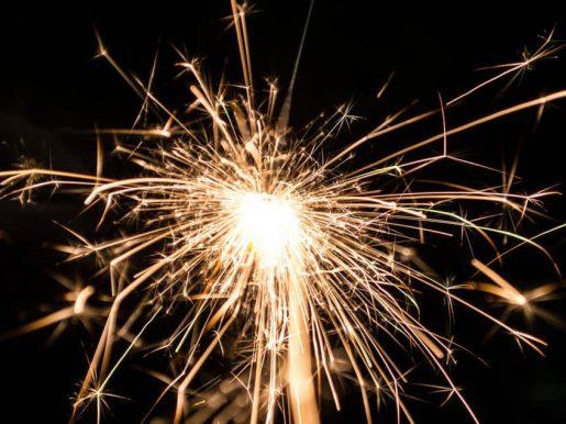 A sparkler ignited on a black background.