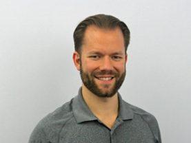 A portrait of Dr. Justin Sullivan.